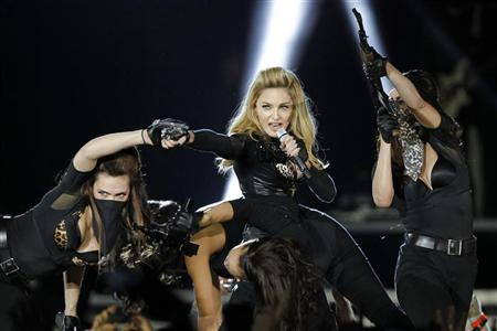 U.S. pop singer Madonna performs during a concert for her MDNA world tour at the Stade de France Stadium in Saint-Denis, near Paris, July 14, 2012. REUTERS/Benoit Tessier