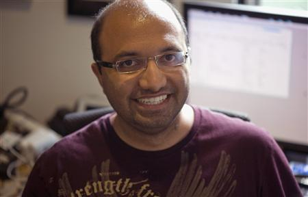Computer benchmark tester Anand Shimpi poses for Reuters in his office in Raleigh, North Carolina July 10, 2012. REUTERS/Noel Randewich