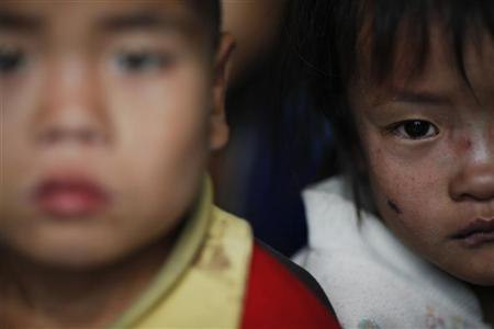 North Korean children wait to be examined for possible signs of malnutrition in an orphanage in an area damaged by summer floods and typhoons in South Hwanghae province, October 1, 2011. REUTERS/Damir Sagolj