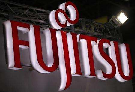 A logo of Fujitsu is pictured at a trade show for Japan's manufacturing industry in Tokyo June 20, 2012. REUTERS/Yuriko Nakao