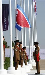 The flag of North Korea is raised during a welcoming ceremony for the team in the Athletes Village at the Olympic Park ahead of the London 2012 Olympic Games July 25, 2012. REUTERS/Luke MacGregor