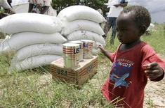 A boy walks at a food aid distribution centre in Chirumanzi, Zimbabwe. January 15, 2009. REUTERS/Philimon Bulawayo