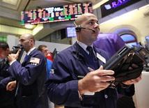 Traders work on the floor of the New York Stock Exchange, July 26, 2012. REUTERS/Brendan McDermid