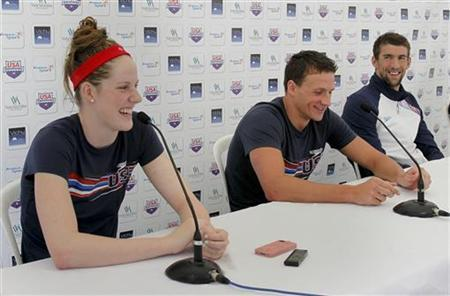 (L to R) Members of U.S. national Olympic swimming team Missy Franklin, Ryan Lochte and Michael Phelps attend a news conference after a training session for the London 2012 Olympics, in Bellerive, July 21, 2012. REUTERS/Robert Pratta
