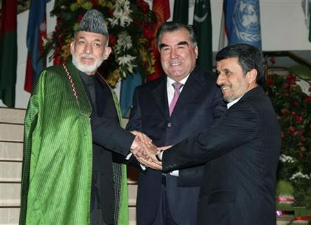 (From L to R) Afghan President Hamid Karzai, Tajikistan President Imomali Rakhmon and Iranian President Mahmoud Ahmadinejad pose for pictures during a meeting in Dushanbe, March 25, 2012. REUTERS/Stringer