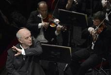 Argentine conductor Daniel Barenboim directs Beethoven's ninth symphony in honor of Pope Benedict XVI (not pictured) at La Scala in Milan June 1, 2012. REUTERS/Daniel Dal Zennaro/Pool