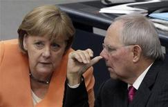 German Chancellor Angela Merkel chats with Finance Minister Wolfgang Schaeuble during a session in Berlin, July 19, 2012. REUTERS/Tobias Schwarz