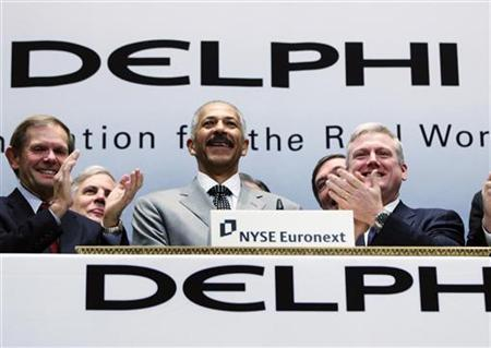 Rodney O'Neal (C), Chief Executive Officer of Delphi Automotive LLP, smiles after ringing the opening bell at the New York Stock Exchange November 18, 2011. REUTERS/Shannon Stapleton