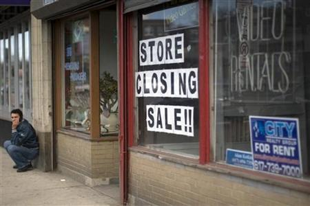 A man talks on his mobile phone outside a now closed store in the Allston neighborhood of Boston, Massachusetts March 31, 2009. REUTERS/Brian Snyder