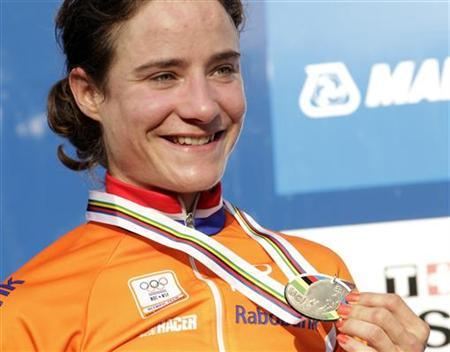 Marianne Vos of the Netherlands poses with her silver medal on the podium of the women's road race elite event at the UCI World cycling championships in Copenhagen September 24, 2011. REUTERS/Denis Balibouse