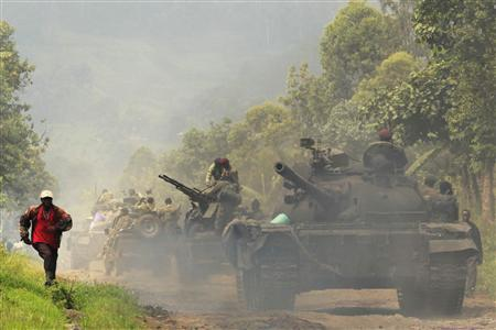 Government troops and tanks are seen in the eastern Congolese town of Rumangabo, July 26, 2012. REUTERS/James Akena