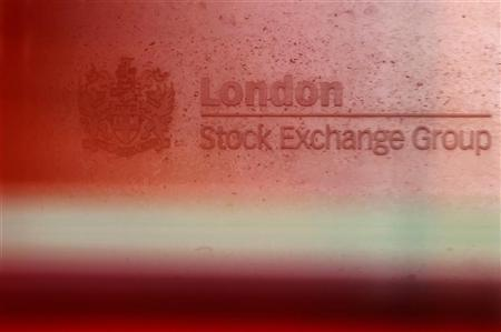 A red London bus passes the Stock Exchange in London February 9, 2011. REUTERS/Luke MacGregor