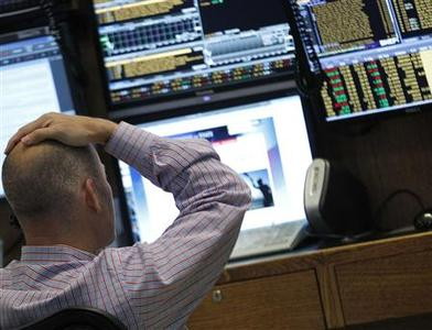 A trader watches his screens on the floor of the New York Stock Exchange, July 27, 2012. REUTERS/Brendan McDermid