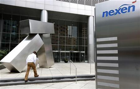 A man walks into the Nexen building in downtown Calgary, Alberta, July 23, 2012.REUTERS/Todd Korol