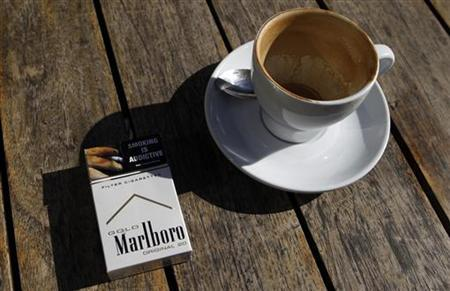 A Marlboro cigarettes pack, a brand of Philip Morris Tobacco, lies next to an empty coffee cup at a cafe in central Sydney June 27, 2011. REUTERS/Daniel Munoz