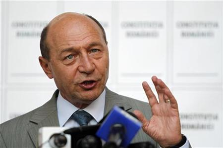 Romania's suspended President Traian Basescu addresses media at his campaign headquarters in Bucharest July 27, 2012. REUTERS/Bogdan Cristel