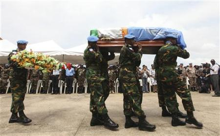 U.N. (United Nations) peacekeepers from Bangladesh carry the coffin of one of seven U.N. peacekeepers from Niger who were killed on June 8, 2012 in western Ivory coast near the Liberia border, during a ceremony at U.N. headquarters in Abidjan June 14, 2012. REUTERS/Luc Gnago