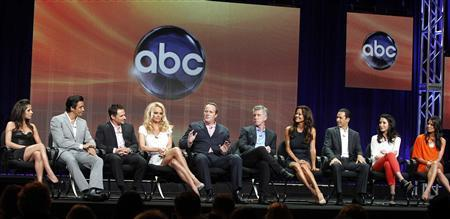 The cast members of the upcoming reality series ''Dancing with the Stars: All Stars'' along with hosts and executive producer (L-R) Kelly Monaco, Giles Marini, Drew Lachey, Pamela Anderson, executive producer Conrad Green, hosts Tom Bergeron, Brooke Burke-Charvet, Helio Castroneves, Bristol Palin and Melissa Rycroft speak during a panel discussion at the Disney-ABC Television Group portion of the Television Critics Association Summer press tour in Beverly Hills, California July 27, 2012. REUTERS/Fred Prouser
