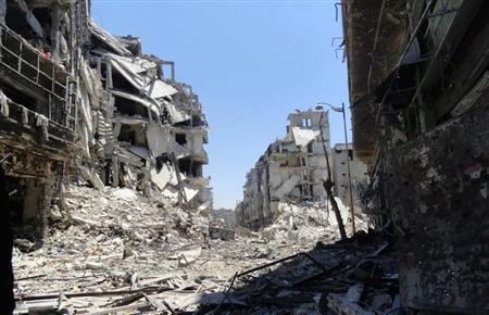 Damaged buildings are seen in Juret al-Shayah in Homs July 27, 2012. REUTERS-Shaam News Network-Handout