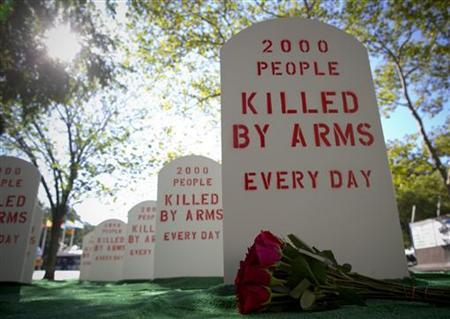 Campaigners for the Control Arms coalition set up a mock graveyard next to the United Nations building in New York, July 25, 2012. REUTERS/Andrew Kelly/Control Arms/Handout