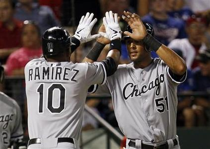 Chicago White Sox's Alexei Ramirez (L) and Alex Rios celebrate Ramierez's home run against the Texas Rangers in the ninth inning of their MLB American League baseball game in Arlington, Texas July 27, 2012. REUTERS/Mike Stone