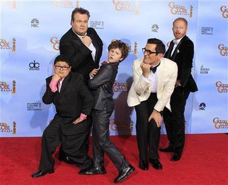 Cast members of ''Modern Family'' (L-) Rico Rodriguez, Eric Stonestreet,Nolan Gould, Ty Burrell and Jesse Tyler Ferguson,winners of best tv series comedy or musical pose in the photo room at the 69th annual Golden Globe Awards in Beverly Hills, California, January 15, 2012. REUTERS/ Lucy Nicholson