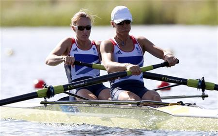 Britain's Helen Glover and Heather Stanning row during the women's rowing pair heat at the Eton Dorney during the London 2012 Olympic Games July 28, 2012. REUTERS/Jim Young