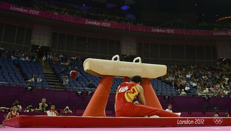 Zhang Chenglong of China reacts after falling off the pommel horse at the men's gymnastics qualification in the North Greenwich Arena during the London 2012 Olympic Games July 28, 2012. REUTERS/Dylan Martinez