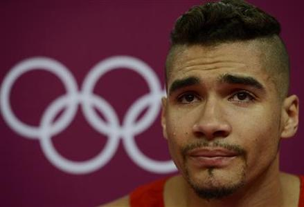 Louis Smith of Great Britain cries during the men's gymnastics qualification in the North Greenwich Arena during the London 2012 Olympic Games July 28, 2012. REUTERS/Dylan Martinez