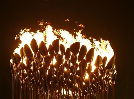 The Olympic cauldron is seen lit during the opening ceremony of the London 2012 Olympic Games at the Olympic Stadium July 27, 2012. REUTERS/Kai Pfaffenbach