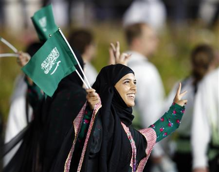 Saudi Arabia's contingent takes part in the athletes parade during the opening ceremony of the London 2012 Olympic Games at the Olympic Stadium July 27, 2012. REUTERS/Suzanne Plunkett