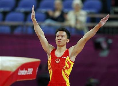 China's Guo Weiyang competes on the vault during the men's qualification in the North Greenwich Arena during the London 2012 Olympic Games July 28, 2012. REUTERS/Mike Blake