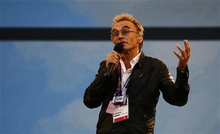 Danny Boyle, director of the London 2012 Olympic Games opening ceremony, speaks before the start of the ceremony at the Olympic Stadium July 27, 2012. REUTERS/Kai Pfaffenbach
