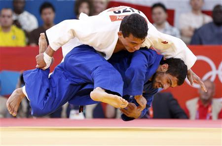 Uzbekistan's Rishod Sobirov fights with Russia's Arsen Galstyan (blue) during their men's -60kg semi-final of table A judo match, at the London 2012 Olympic Games July 28, 2012. REUTERS/Kim Kyung-Hoon