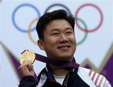 South Korea's Jin Jong-oh poses with his gold medal at the victory ceremony for the men's 10m air pistol event at the London 2012 Olympic Games in the Royal Artillery Barracks at Woolwich in London July 28, 2012. REUTERS/Eddie Keogh