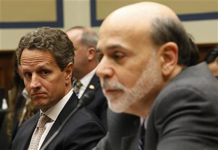 U.S. Secretary of the Treasury Tim Geithner (L) listens to Federal Reserve Board Chairman Ben Bernanke (R) during testimony before the House Committee on Oversight and Government Reform in Washington March 21, 2012. REUTERS/Gary Cameron