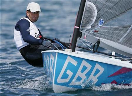 Ben Ainslie of Britain sails in the Finn class during a practice race at the London 2012 Olympic Games in Weymouth and Portland, southern England, July 28, 2012. REUTERS/Pascal Lauener