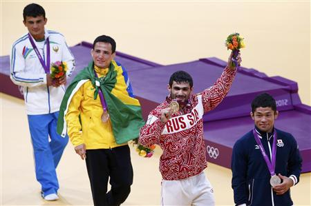 Silver medallist Japan's Hiroaki Hiraoka, gold medallist Russia's Arsen Galstyan, bronze A medallist Brazil's Felipe Kitadai and bronze B medallist Rishod Sobirov (R-L) celebrate after the awards ceremony for the men's -60kg final judo match, at the London 2012 Olympic Games July 28, 2012. REUTERS/Darren Staples