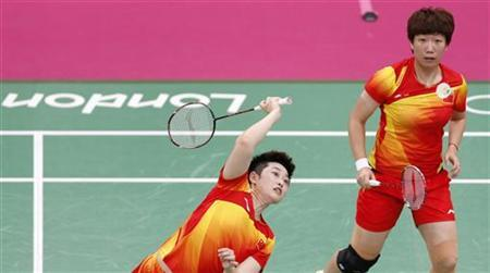 China's Wang Xiaoli and Yang Yu (L) play against Canada's Alex Bruce and Michele Li during their women's doubles group play stage badminton match at the Wembley Arena during the London 2012 Olympic Games July 28, 2012. REUTERS/Bazuki Muhammad