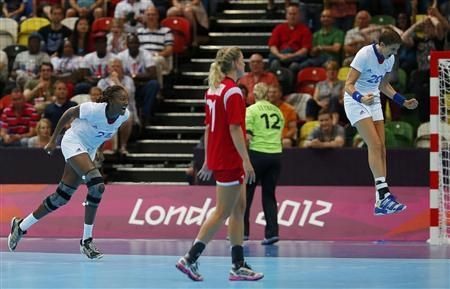 France's Raphaelle Tervel and Mariama Signate (L) celebrate after defeating Norway in their women's handball Preliminaries Group B match at the Copper Box venue of the London 2012 Olympic Games July 28, 2012. REUTERS/Marko Djurica