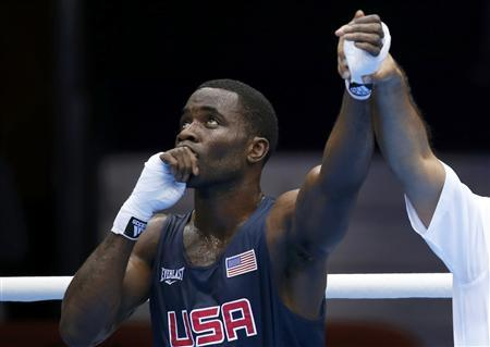 Terrell Gausha of the U.S. reacts after defeating Armenia's Andranik Hakobyan in the Men's Middle (75kg) Round of 32 Bout 8 boxing match at ExCeL venue during the London 2012 Olympic Games July 28, 2012. REUTERS/Murad Sezer