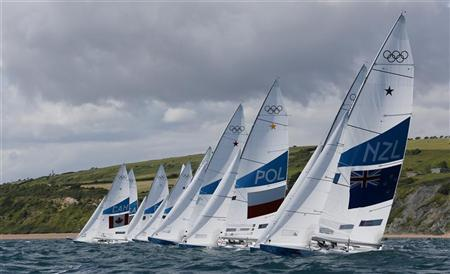 A fleet of Star class keelboats starts during a practice race at the London 2012 Olympic Games in Weymouth and Portland, southern England, July 28, 2012. REUTERS/Pascal Lauener