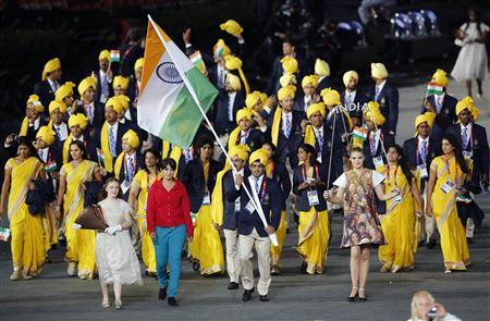 India's flag bearer Sushil Kumar holds the national flag as he leads the contingent in the athletes parade during the opening ceremony of the London 2012 Olympic Games at the Olympic Stadium July 27, 2012. REUTERS/Mike Blake