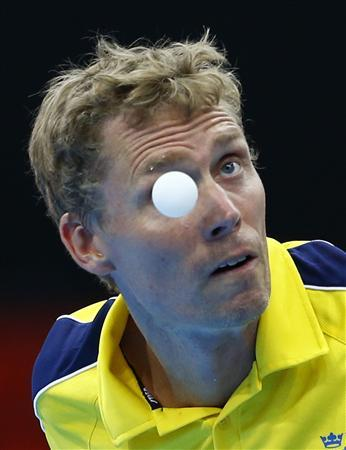 Sweden's Jorgen Persson serves to Nigeria's Segun Toriola during their men's singles first round table tennis match at the ExCel venue of the London 2012 Olympic Games in London July 28, 2012. REUTERS/Grigory Dukor