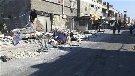 Damaged buildings are seen at Al-Assali neighbourhood in Damascus July 28, 2012. REUTERS/Shaam News Network/Handout