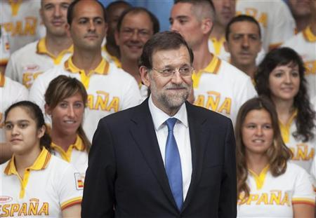 Spain's Prime Minister Mariano Rajoy poses with members of the Spanish national Olympic team ahead of the London 2012 Olympic Games at Moncloa Palace in Madrid July 23, 2012. REUTERS/Juan Medina