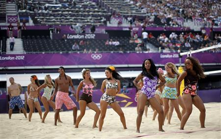 Actors perform during a show in between beach volleyball matches at the Horse Guards Parade during the London 2012 Olympic Games July 28, 2012. REUTERS/Marcelo Del Pozo