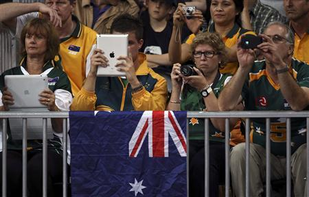 Fans of Australia take pictures with their iPads and cameras during their men's Group A volleyball match against Argentina at the London 2012 Olympic Games at Earls Court July 29, 2012. REUTERS/Ivan Alvarado