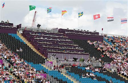 Empty seats reserved for VIPs and athletes are seen at the Eventing Individual Dressage at the London 2012 Olympic Games in Greenwich Park on July 29, 2012. REUTERS/Olivia Harris