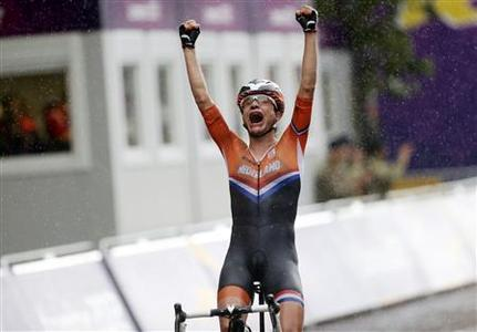 Netherlands' Marianne Vos reacts as she crosses the finish line to win the women's cycling road race final at the London 2012 Olympic Games July 29, 2012. REUTERS/Stefano Rellandini